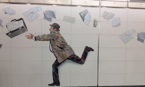 decluttering-man-with-papers